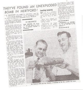 Article containing photograph of two men, Mr. H. Botsford, Botsford & Sons and Mr. Gregory looking at an unexploded bomb found on July 1961 in Dimsdale Street. It was thought to be from the raid.   Hertfordshire Mercury