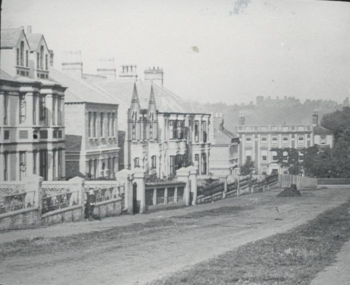 Looking down Ques Road towards Bayley Hall.  Some of these houses were later demolished to create Hale Road | Mr Elsden, Hertfordshire Archives and Local Studies