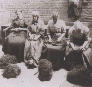 Women in a workhouse picking oakum