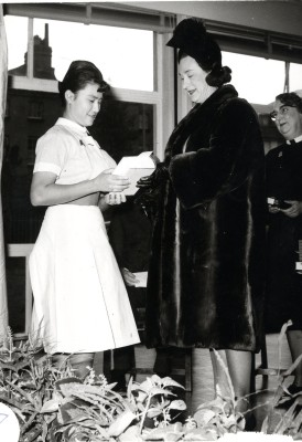Janet Williams (?) receiving a prize from Barbara Cartland