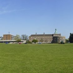 Panoramic view of the building sandwiched between sky and grass | Richard Brockbank