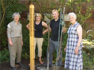 The peace pole being 'planted'