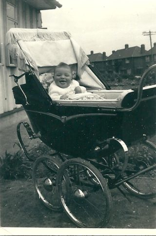 Me, Philip Wright in my pram outside the prefab No. 50 Cecil Road (1955)