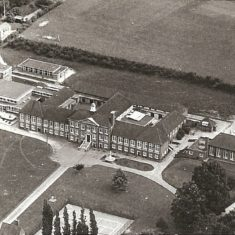 Arial view of the extneded school.  The open air swimming pool is on the right of the picture.