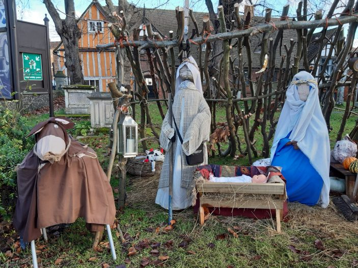 St Andrew's Church Christmas Display in church yard - The baby has been born in the manger with life-sized figures of Joseph and Mary and the donkey looking on | Gill Cordingley
