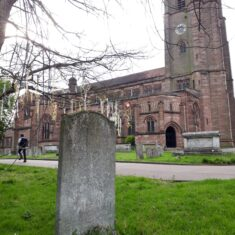 Grave stone with church in the background | Susan Payne
