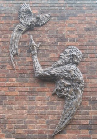 Rodney Munday's sculpture of Alfred Russel Wallace on the exterior of Hertford Theatre