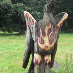 A wood sculpture by one fo the men who now work at the site