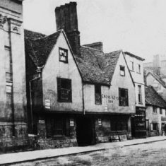 The Cross Keys Inn, whose cellars were partly under the Corn Exchange, was demolished and replaced by the building that housed Wilson's and a grocer's shop. The Cross Keys sign was initially preserved on top of the building but urgent repair work on the upper part in the 1950s resulted in its disappearance. Wilson's was replaced by the wine merchants Peter Dominic then Thresher, and the grocer's shop became the local branch of the National Provincial Bank, later the Leeds Building Society office. | Hertfordshire Archives and Local Studies