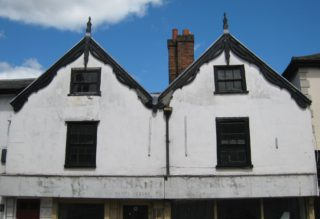 The twin gables, with their early 19th-century Gothic moulded and traceried bargeboards, of the former King's Head Inn