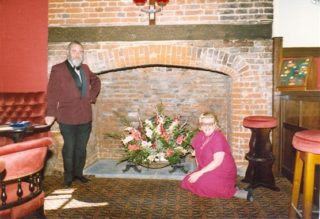 Gerry and Kathie Marsh in front of the newly discovered fireplace