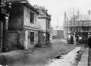 Damage caused to buildings in Bull Plain, probably nos.27 & 29.  Lombard House is in the background faced with scaffolding | Hertfordshire Archives and Local Studies