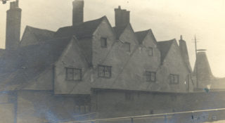 The rear of Lombard House, c. 1910, revealing its medieval origins, which are still evident today