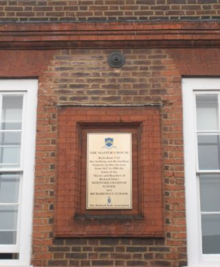 The plaque on the front of The Master's House in Fore Street