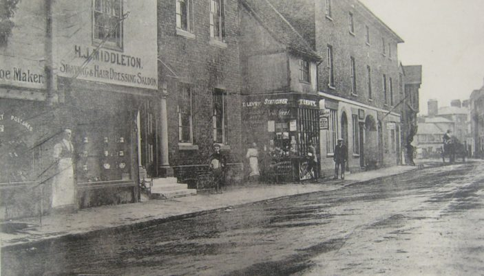 The south side of St Andrew Street in the early 20th century, showing Halmond J. Middleton's hairdressing salon | Hertfordshire Archives & Local Studies