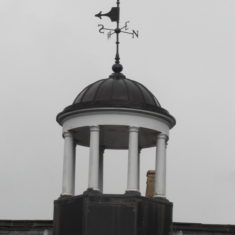 The weather vane on top of the stable block