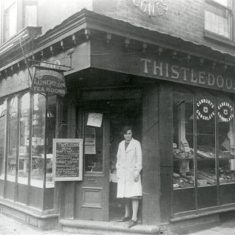 The Thistledoo luncheon and tea rooms were on the corner of Market Street and Fore Street (31 Fore Street). This photograph was taken in 1926 when Louisa Munday and James Roberts (brother and sister) ran it. Richardson & Schaeffer were the previous owners. It was demolished in the mid-1930s so that the Fore Street end of Market Street could be widened to make way for a bus stop. The bus office opened next door from 1932 until the war years. | Hertfordshire Archives and Local Studies