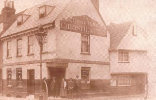 The Three Tuns public house, showing the landlord, Colin Lees, on the left-hand side wearing a straw hat, c. 1910-12