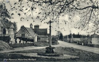 Waterford School behind the War Memorial | Hertfordshire Archives and Local Studies