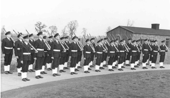 Doug back row between 5 & 6 in the front row; Petty Officer Garnham is 1st left and Stan Baker 3rd left in front row
