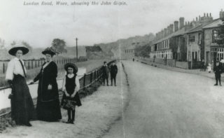 Postcard showing the original pub on the right | Herts Archives