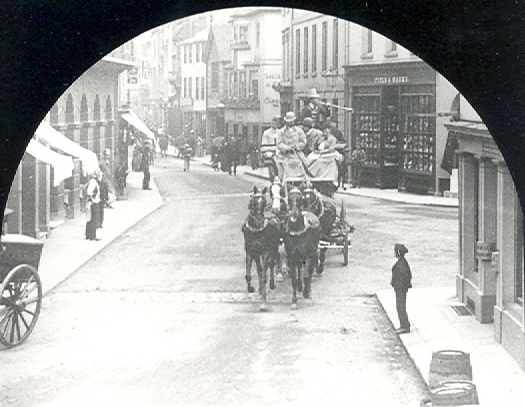 An unidentified coach entering Parliament Square, Hertford, from Fore Street, c. 1850 | Hertfordshire Archives & Local Studies