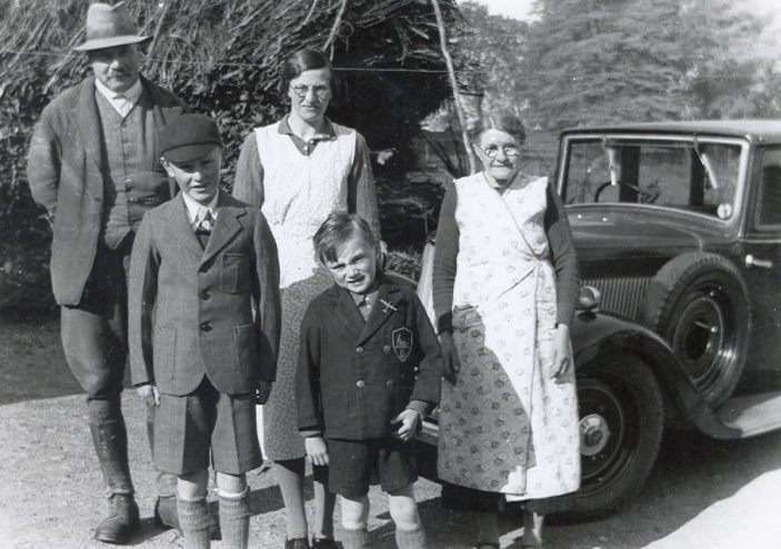 Doug, front right, and Stanley with the Coles family, John on the left, Dorothy in the middle and Clara on the right